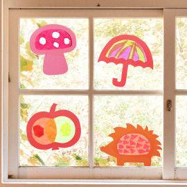 Sun Catcher mit Herbstmotiven im Fenster
